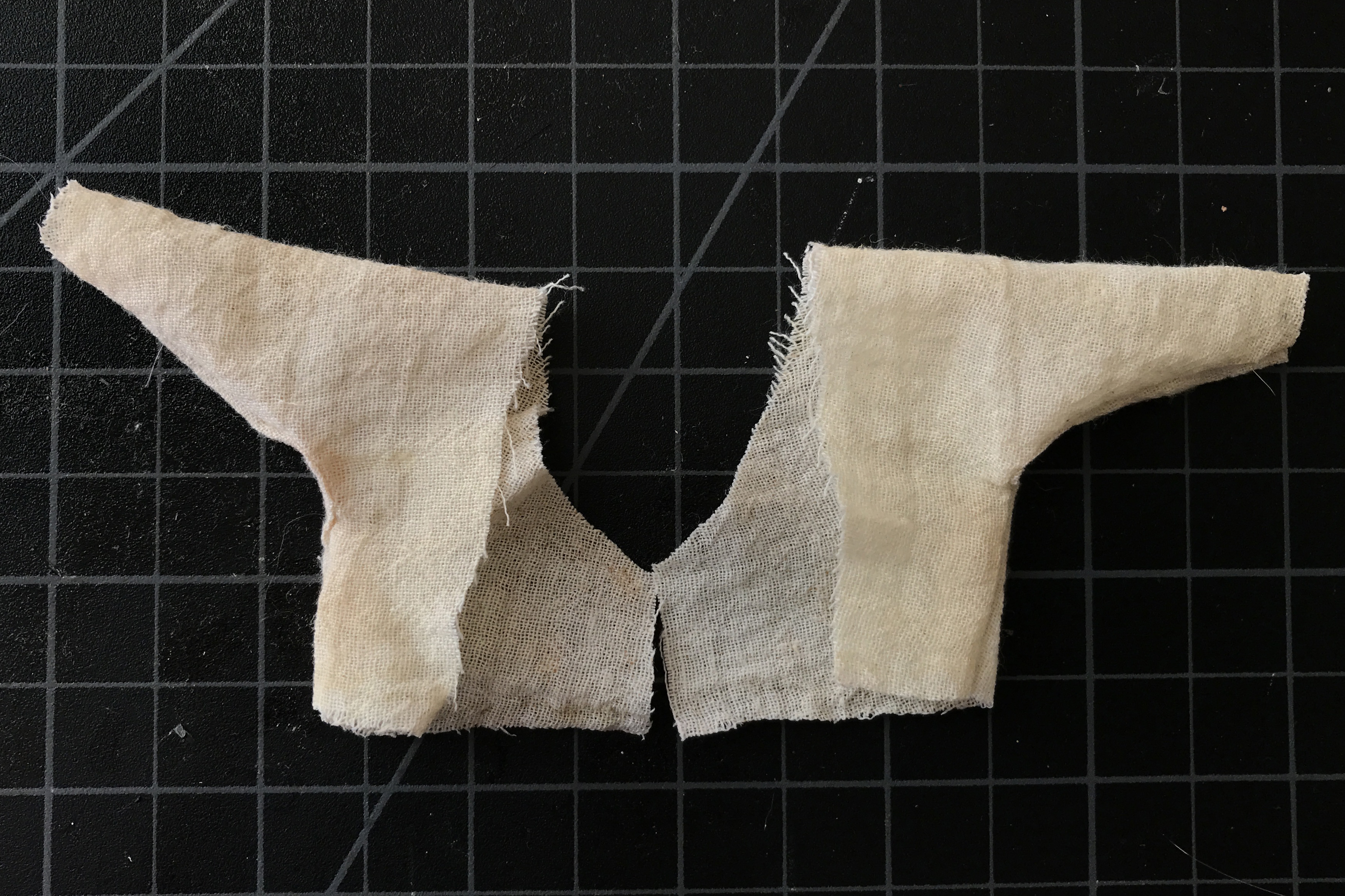Get this DIY tutorial on how to make a tunic shirt for your action figures, no sewing required! An easy way to make your toy photography subject life-like!